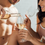 stock-photo-cropped-view-man-pouring-wine